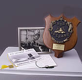 A photo, plaque, ribbons and literature for the USS Trepang