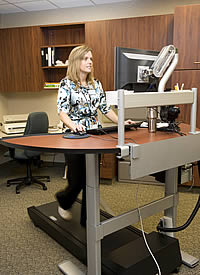 A woman uses an active workstation at the Biomedical Informatics Research Center