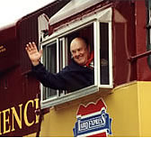 Melvin Laird waves from window of Laird Express train